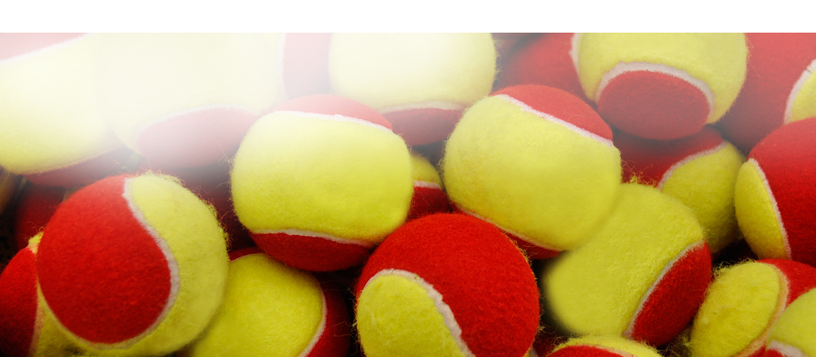 yellow and red tennis balls stacked on top of each other