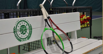 tennis rackets on a bench